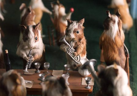 Taxidermied guinea pigs playing little instruments at a cricket match, by Walter Potter.