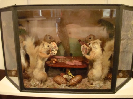 Taxidermy squirrels playing cards around a card table, by Walter Potter.
