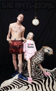 Members of Die Antwoord pose with stuffed leopard and zebra skin rug.