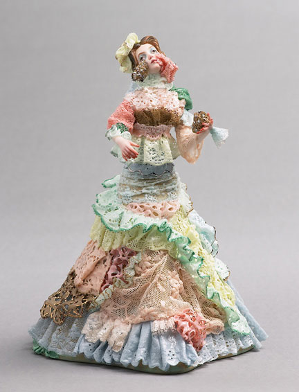 A porcelain figurine of a woman by Shary Boyle.