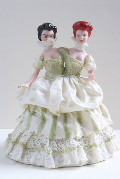 A porcelain figurine of a woman with two heads, by Shary Boyle.