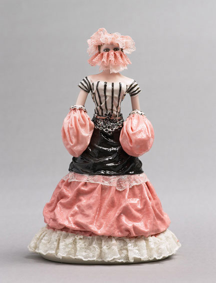 A porcelain figurine of a woman being drowned in the fabric of her own dress, by Shary Boyle.