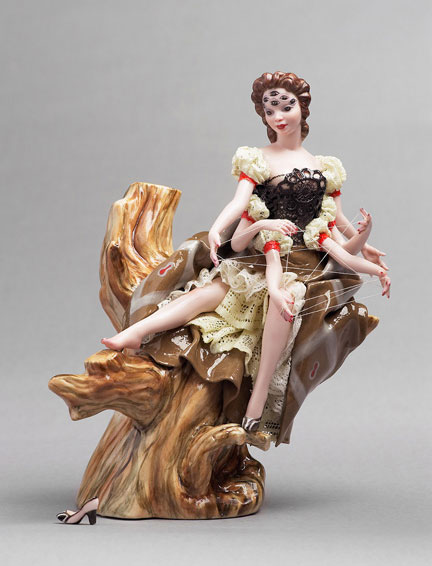 A porcelain figurine of a woman with eight spider-like limbs, by Shary Boyle.