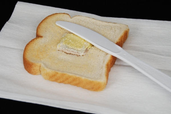 Judith G Klausner, Embroidered Toast #2: Butter (To Go), 2010. Toast, thread, paper, napkin, plastic knife.