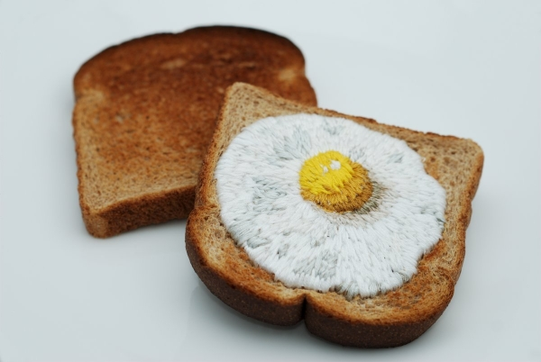 Judith G Klausner, Toast Embroidery #1: Egg on Toast, 2010. Toast, thread, paper.