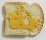 Map of Canada made from processed cheese on white bread made by Tibi Tibi Neuspiel.