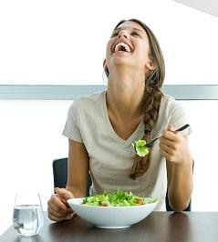 Ad with woman laughing alone with salad