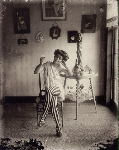 E.J. Bellocq's photograph of Storyville prostitute with striped stockings