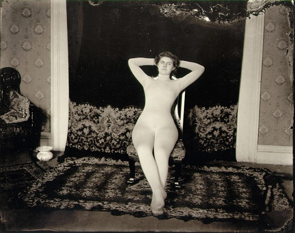 E.J. Bellocq's photograph of Storyville prostitute with full body stocking.