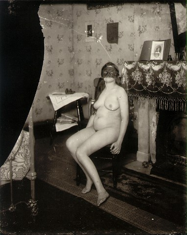 E.J. Bellocq's photograph of Storyville prostitute with mask