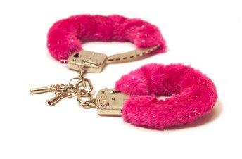 Museum of Broken Relationships pink fur handcuffs