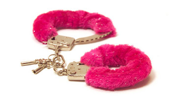 Museum of Broken Relationships pink fur handcuffs