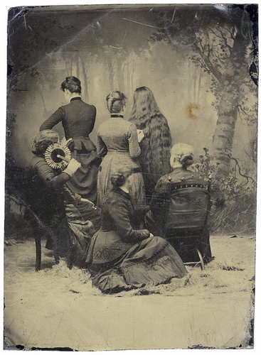 Group of Victorian women facing backward.