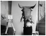 Pablo Picasso wearing a bull's mask.