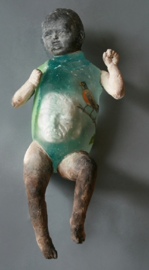 Christina Bothwell's translucent glass sculpture of baby with face in stomach