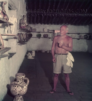 Pablo Picasso shirtless with pottery