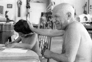 Pablo Picasso shirtless.