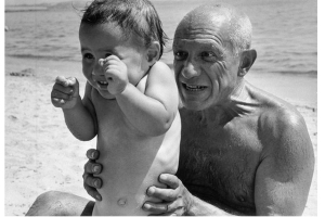Picasso without his shirt on with a baby
