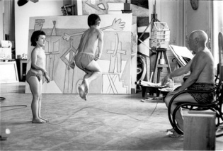 Pablo Picasso shirtless and skipping with kids.