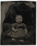 Victorian photograph of a child with mother disguised in the background.