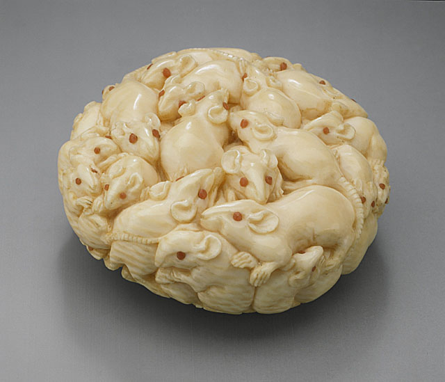 An ivory netsuke depicting a cluster of rats.