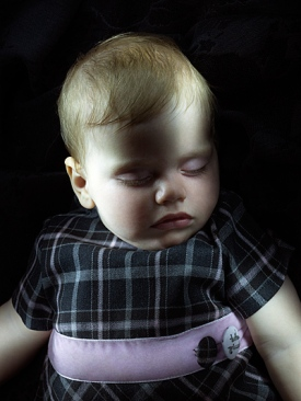 Baby model looks like Victorian post-mortem photography