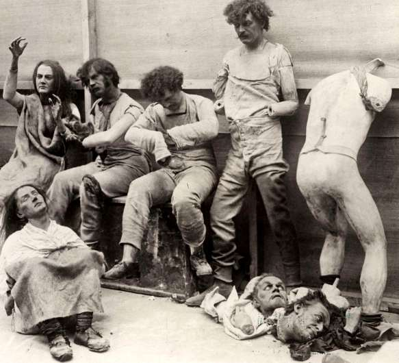 Photograph of six wax figures and broken body parts damaged from 1929 fire at Madame Tussaud's in London.