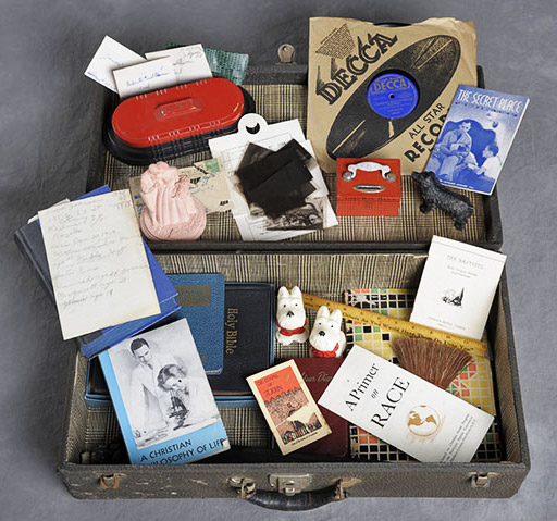 Case with Bible, Christian philosophy booklet, dog figurines, record and rulers.