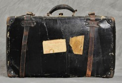 Old, battered black suitcase.
