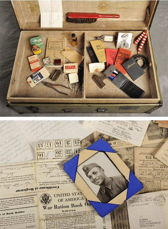 Suitcase showing war porait and ration book, other personal items