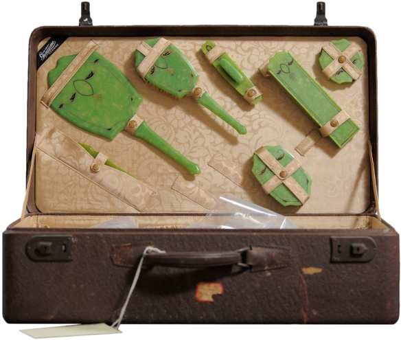 Case with green enamel hair brush set strapped to lid.