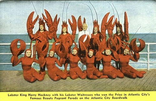 Lobster king Harry Hackney with his Lobster Waitresses, who won the prize in Atlantic City's famous beauty pageant parade, date unknown.