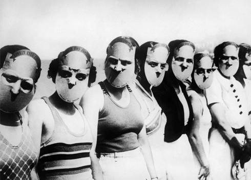 Contestants of the Miss Lovely Eyes competition (Florida, 1930s) pose with creepy face blocking masks.