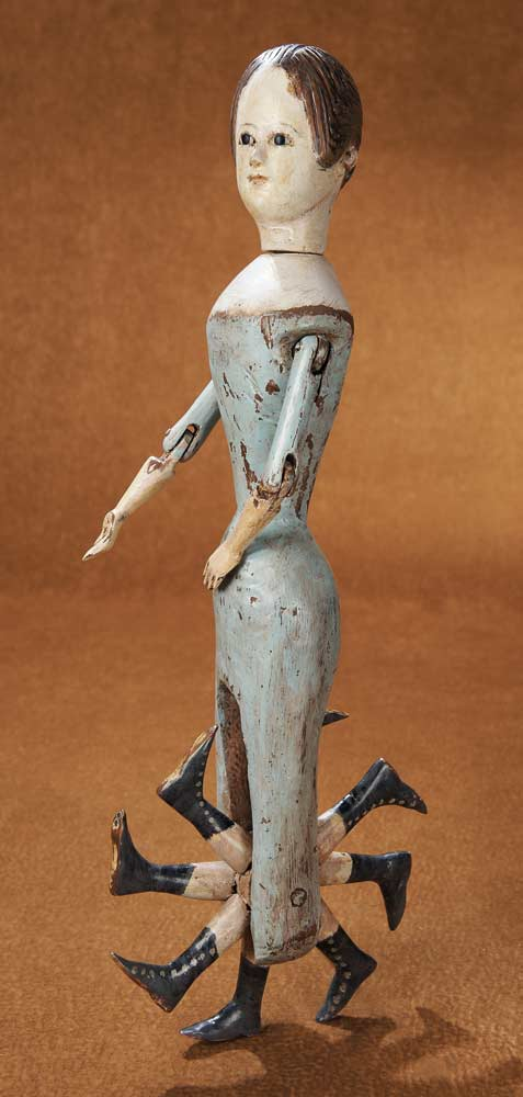 Rare early nineteenth century walking doll with eight legs that rotate like a wheel.