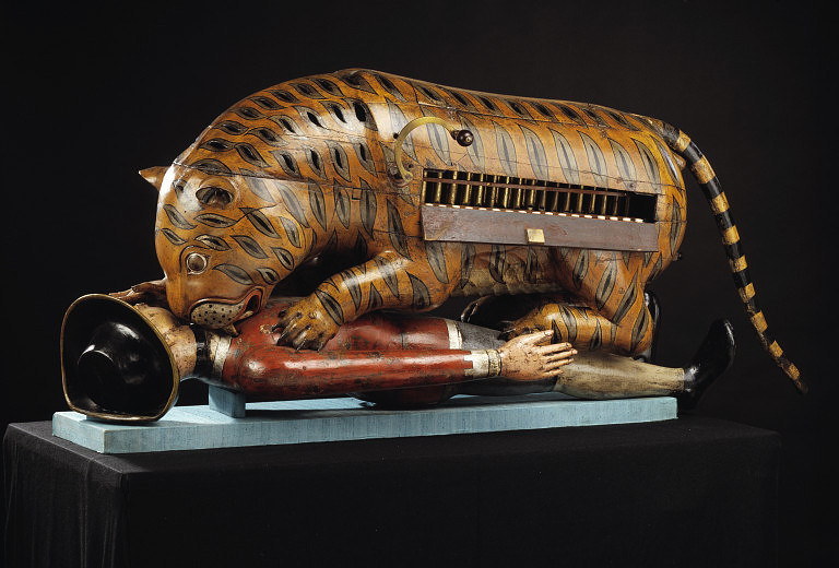 Life size 18th century automaton of tiger eating European man from the Victoria and Albert Museum