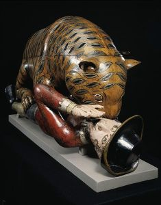 Detail view of Tipus Tiger automaton, showing man arm raised to fend off the tiger