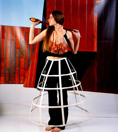 Image from Christian Thompson's Emotional Striptease (2003), (woman in skirt hooping)
