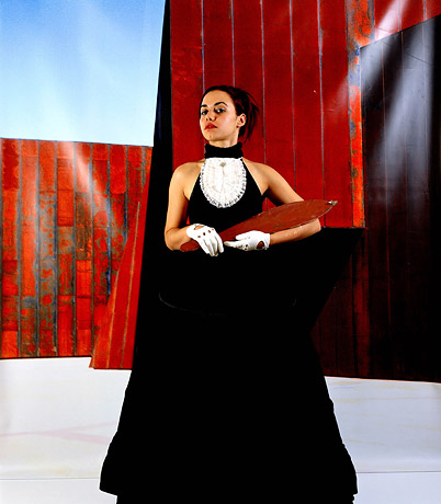 Image from Christian Thompson's Emotional Striptease (2003), (woman in black with white gloves)