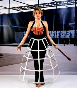 Image from Christian Thompson's Emotional Striptease (2003), (woman with skirt hooping facing-front)