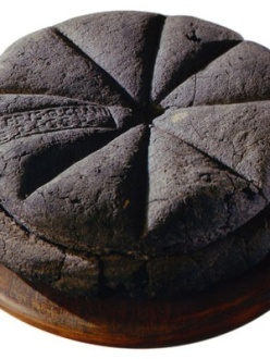 Photograph of a preserved circular loaf of bread discovered at Pompeii