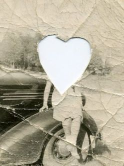 Vintage photograph with head cut out in a heart shape