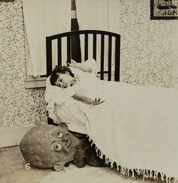 Image of a scary goblin creature peeking out from under the bed of a little girl