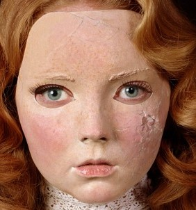 Close up view of Gillian Wearing's photograph of Lily Cole, showing damage to the silicone mask on the right cheek