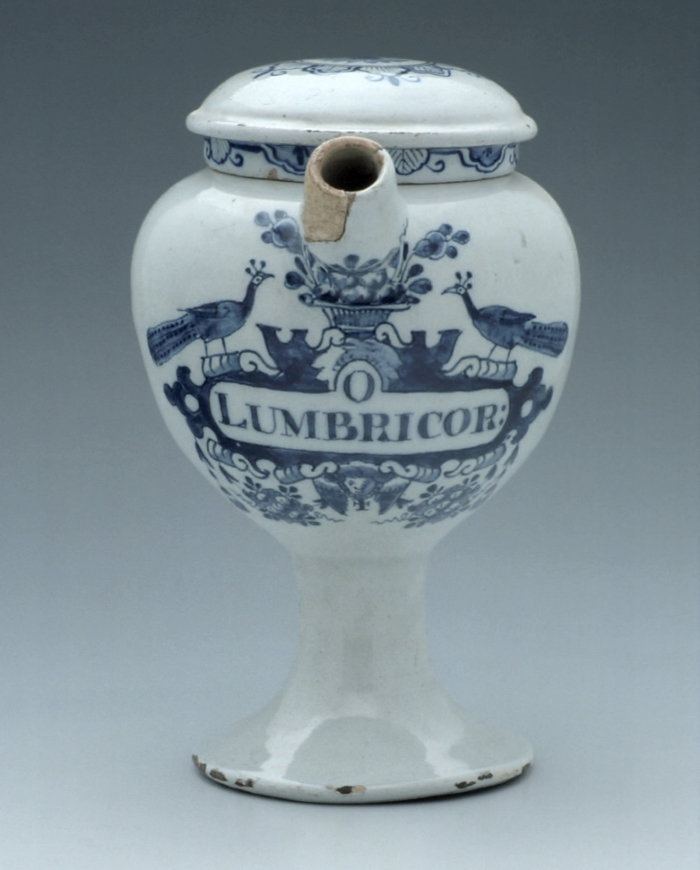 Blue and white ceramic jar with blue decoration of peacocks and a basket of fruit, inscribed Lumbricor