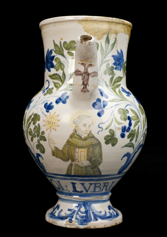 Syrup jar for oil of earthworms, with image of Saint Ignatius painted above words OL.LUBRI