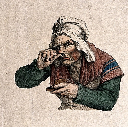 Engraving illustration of an old woman in bonnet snuffing tobacco up her nose so hard that her whole face is contorted.