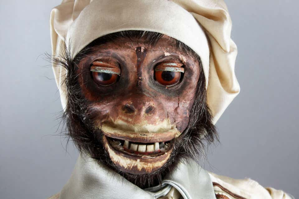 Close view of the creepy face of a 19th century monkey automaton