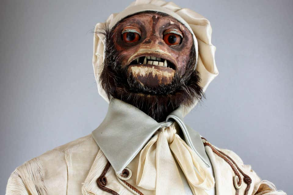 Close view of the face of a 19th century monkey automaton